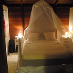 A four poster bed with a mosquito net. Probably not necessary this season.