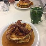 American style pancakes with maple and bacon and a mint tea
