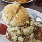 Eggs scrambled with cheese on a roll with home fries. The second picture is The Bo Burger