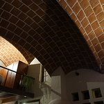 View of loft with arched stone ceilings.