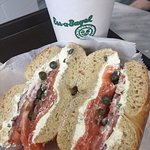 Everything bagel with lox, scallion schmear, tomato and capers