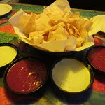 Warm Thin Chips, Red Peppery & Thick Green Sauces