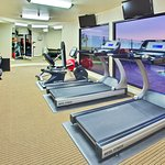 Fitness Center overlooking the outdoor pool area
