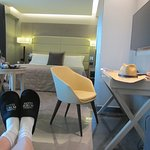 Hotel slippers and a large comfy room
