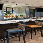 Enjoy happy hour at our G Bar and Bistro
