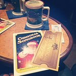 Train ticket, song book and hot chocolate mug