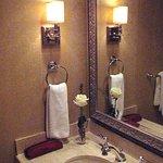 Planters Inn - Room 105 Bathroom sink with rose
