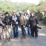 Devendra singh and photographers in the field.