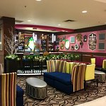 Cute Pineapple bar and seating area in hotel lobby