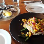 Oysters and grilled snapper fillet