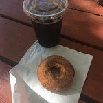 Coffee and a fresh apple cider donut.