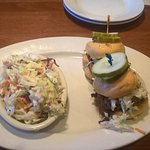 Pulled pork sliders with cole slaw.