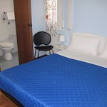 A small but well appointed room with private facilities.