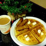A hot waffle, sausage, & delicious coffee...