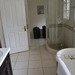Bathroom with separate changing section.