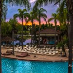 Tropical sunset view from the veranda overlooking the main pool area