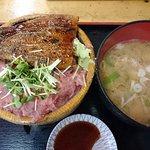 Bowl of rice topped with sashimi (tuna) and BBQ eel
