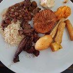 Rice, beans, mandioca frita, steak, polenta frita.
