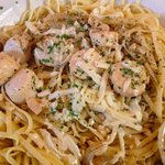 Scallops over linguini.