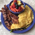 Make your own omelette with black olives,peppers,cheddar cheese,bacon and mushrooms  Side of bac
