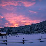 Sunset at the ranch in magical winter wonderland