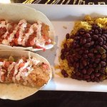 Fish tacos with beans and rice.