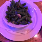 side of green beans flavored with bacon/ham