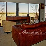 Lounge with fireplace in Boutique with spectacular view over the Dunes