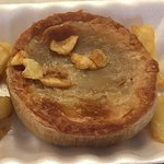 The pie wasn't cooked, the pastry was still raw, the blonde waitress tried to hide it with chips