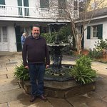 My husband posing by the courtyard fountain