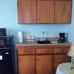 Studio kitchenette with toaster, coffee maker, microwave