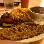 Roast pork was on point! Palomilla steak delectable! Black beans and yellow rice savory! Tostone