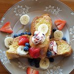 Pain Perdue-Challah french toast stuffed with marscapone cheese, topped w/honey berry butter & f