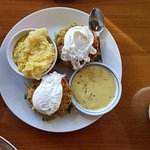 Blue Benedict -Poached eggs, crab cakes, tomato, arugula, english muffin, holllandaise sauce & g