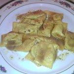 Tortelli di patate , tosone e tartufo nero con crema di funghi porcini