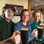 Family sipping on the 22 ounce draught beer!