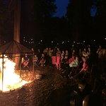 Patrons enjoy an intermission bonfire.