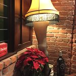 "Hilarious! Christmas Story ""leg"" lamp and BB gun on display."