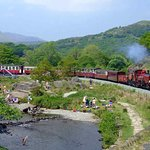 This is a Garatt loco steaming round the Abaglysn pass with 10 coaches.