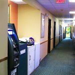 hall look. canned-soda machine, ice, washer/drier, atm just outside office/breakfast area
