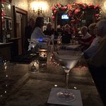 Locals gather at Le Richelieu's bar for a round of Christmas cheer.