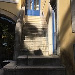 Several sets of stairs lead from the rooms to the beautiful courtyard
