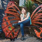 Posing on the butterfly bench at the original JuiceLand is the ultimate Austin photo op!