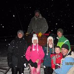 Friendly sleigh driver with family members... and the snow!