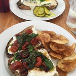 Delicious lunch!! Roasted tomatoes, pesto, greens and goat cheese on rustic bread. The chips wer