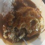 The local dish Loco Moco; a seasoned hamburger patty with eggs, brown gravy & rice.