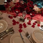 Rose petals on table