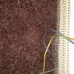 carpet is very old and filthy with an inch or 2 of dust along the baseboards.