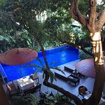 Breakfast (Traditional Akha Pork Soup) and the central atrium with pool
