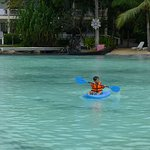 Si Wayne namogsay sa dagat. (Wayne kayaking along the interior beach of the resort).
